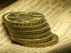 Стоимость золота снижается из-за ослабления спроса на безопасные активы